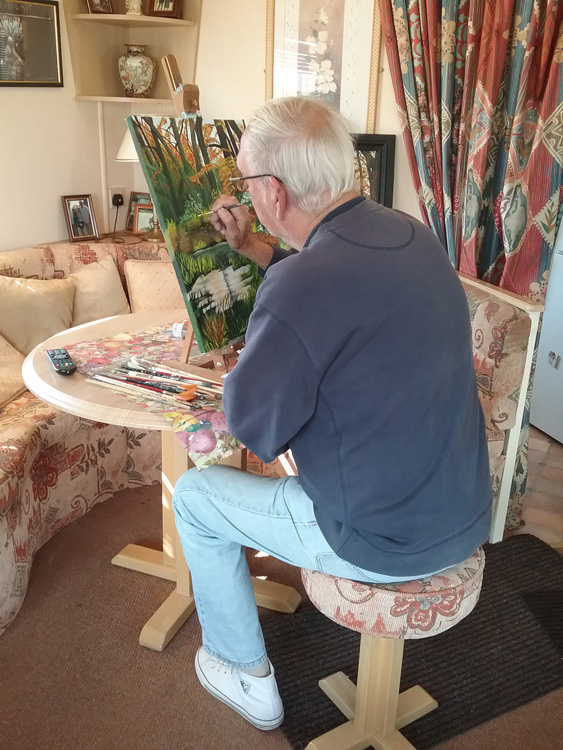 Ernie Thompson painting in his house on the Canary Islands.