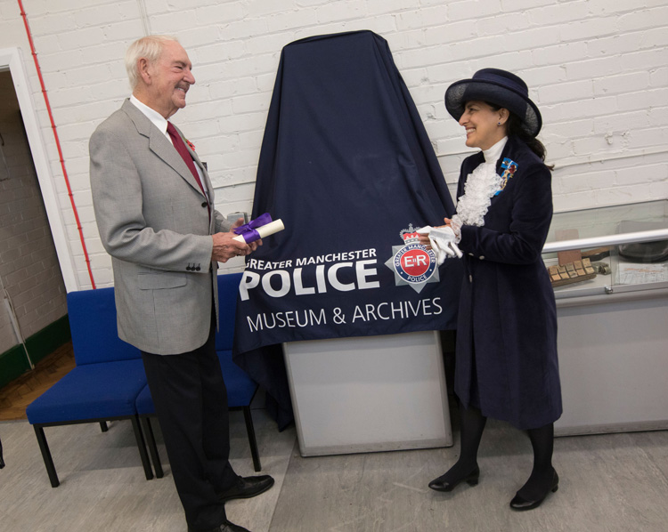 Ernie Thompson receiving his commendation from The High Sheriff of Greater Manchester