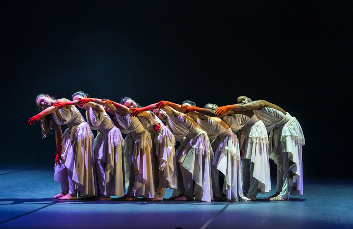 Left to right: Natalie Alleston, Carmen Vazquez Marfil, Manon Adrianow, Vanessa Vince-Pang, Carlos J. Martinez, Michael Marquez, Aaron Chaplin and Prentice Whitlow in Phoenix Dance Theatre and Opera North's The Rite of Spring choreographed by Jeanguy Saintus. Photo by Tristram Kenton.