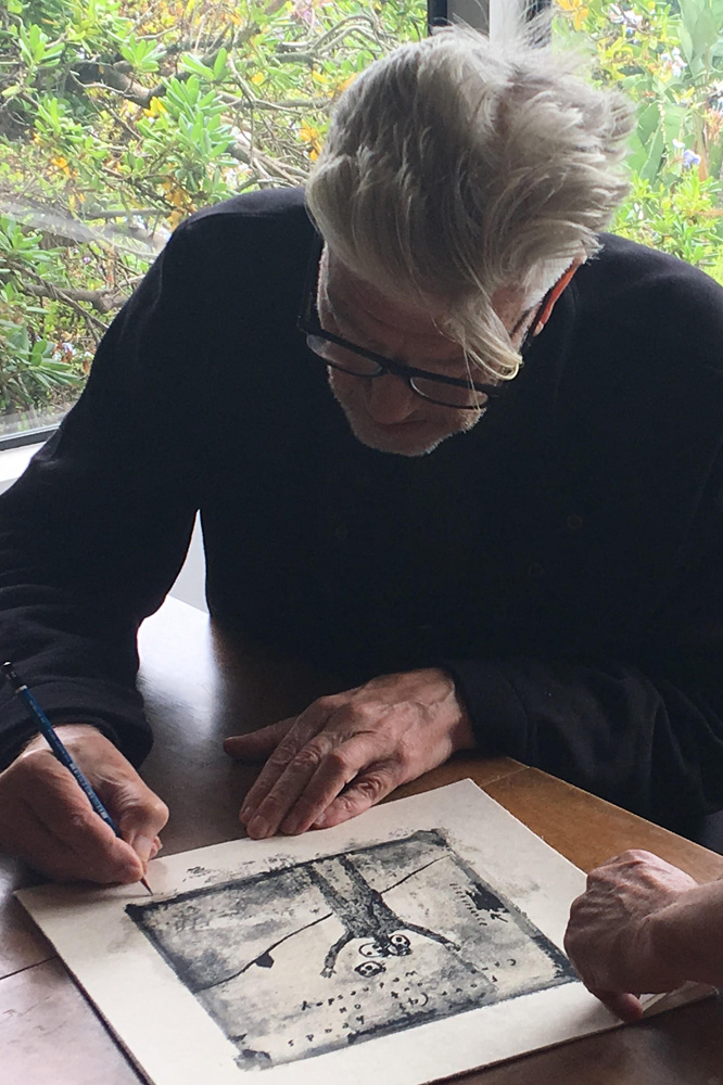 Lynch signing a print of Four (4) Heads Came Out on Wednesday