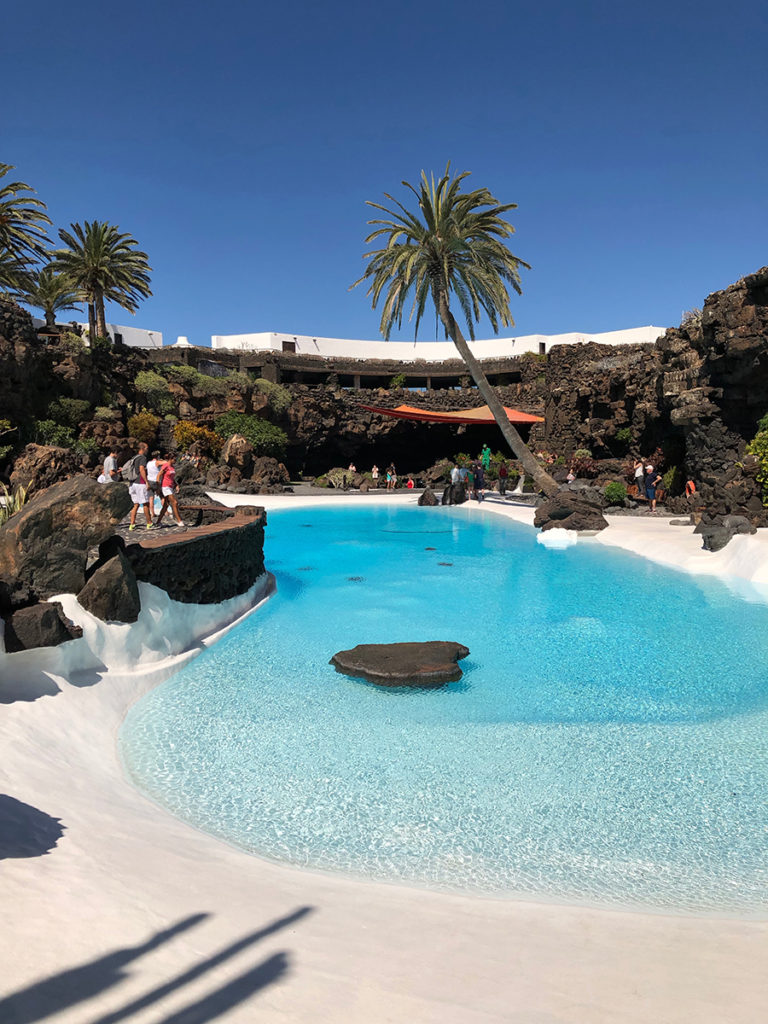 Jameos del Agua – white pool surrounded by palm trees is like a film set