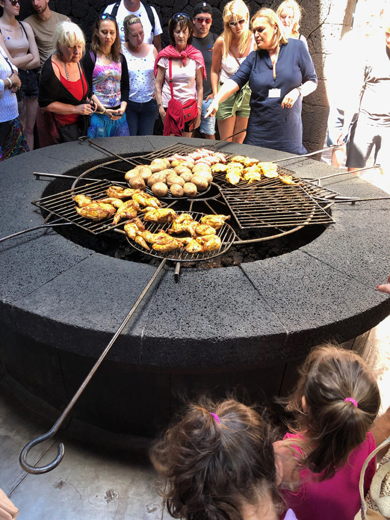 Chicken being cooked on a huge geothermal heated BBQ, Lanzarote