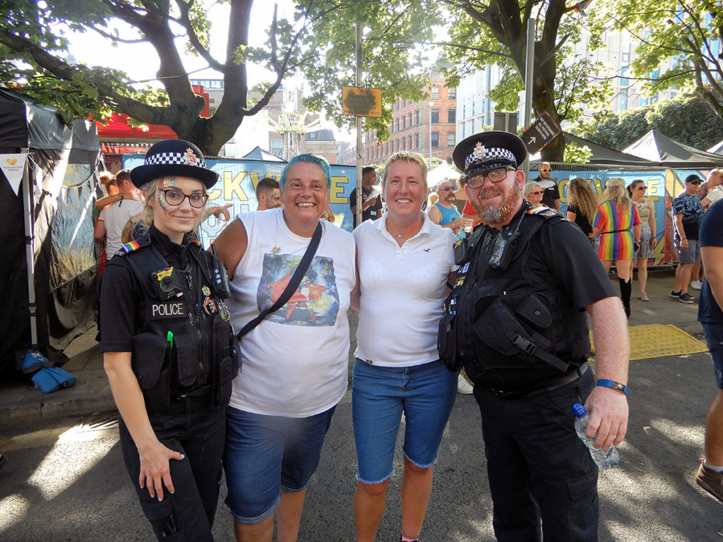 Liz and Georgie with officers from Manchester Police