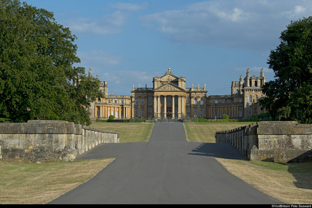 Blenheim Palace, viewed from the bridge. The facade of the building, with elegant portico, built in the 18th century English baroque style.
