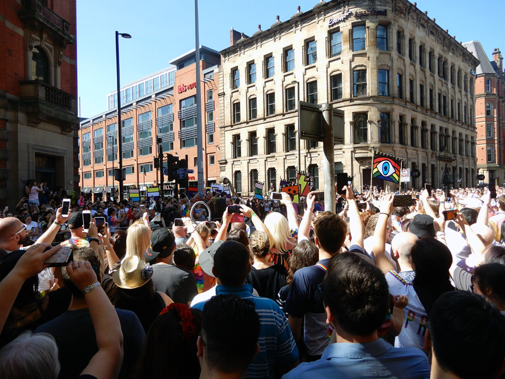 Crowds watching the Manchester Pride parade
