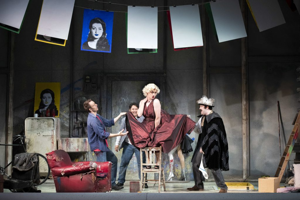 Opera North's production of Puccini's La Bohème Yuriy Yurchuk as Marcello, Eleazar Rodriguez as Rodolfo, Henry Neill as Schaunard and Emyr Wyn Jones as Colline Photo credit: Richard H. Smith