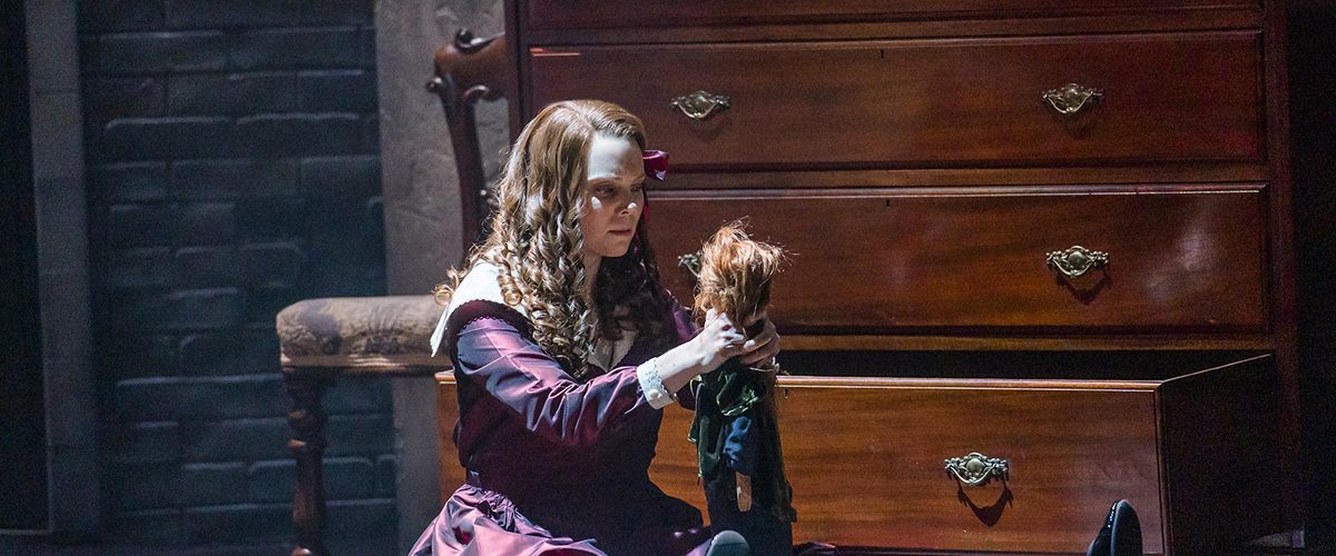 Opera North's production of Britten's The Turn of the Screw Jennifer Clark as Flora. Photo by Tristram Kenton
