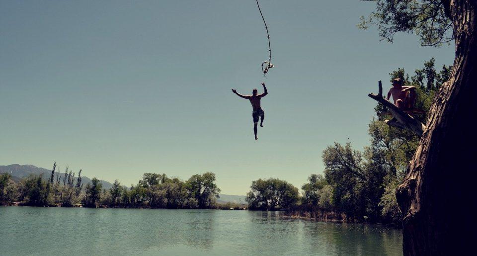Man jumping into lake