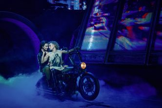 Martha Kirby as Raven and Glenn Adamson as Strat in BAT OUT OF HELL THE MUSICAL. Photo Credit - Chris Davis Studio