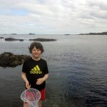 Child with Huckleberry pop up net at the beach