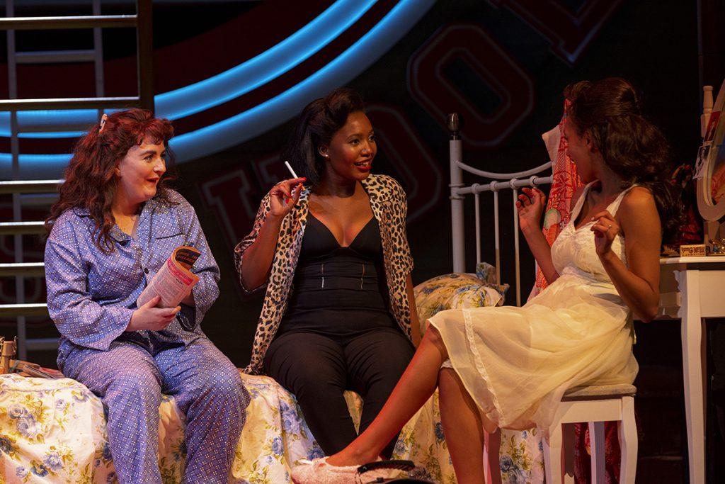 LtoR Maeve Byrne as Jan, Tendai Rinomhota as Rizzo & Inez Budd as Marty in Grease, credit Sean Ebsworth Barnes