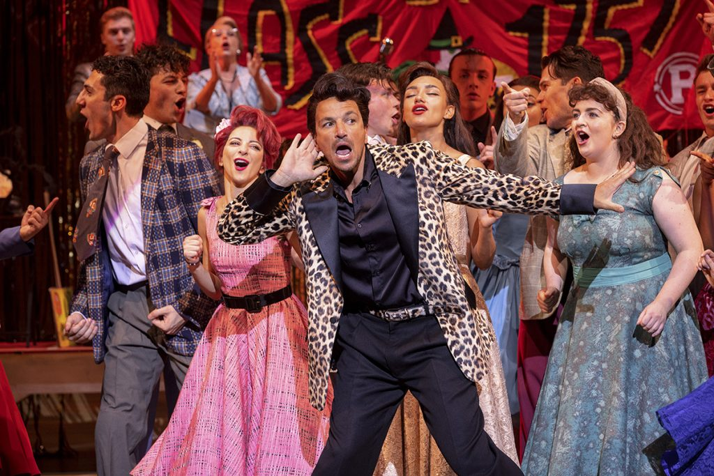 Peter Andre (front centre) as Vince Fontaine in Grease, credit Sean Ebsworth Barnes