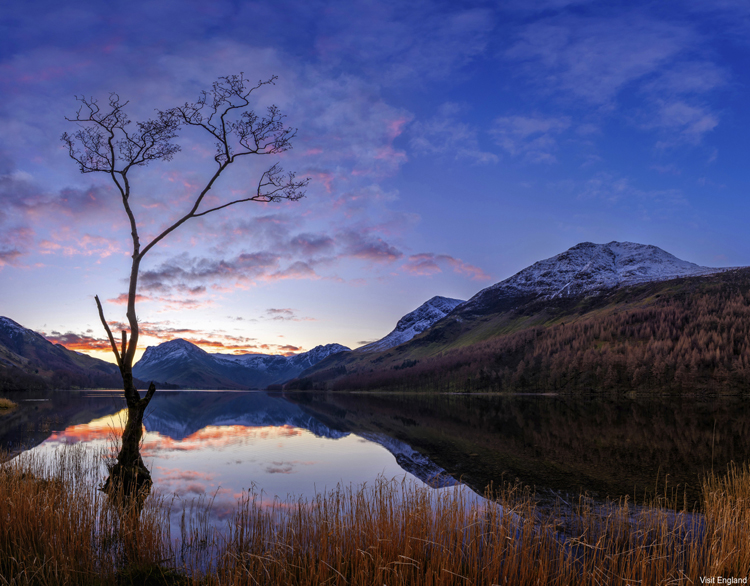 View across Lake Buttermere in the English Lake District at sunset.