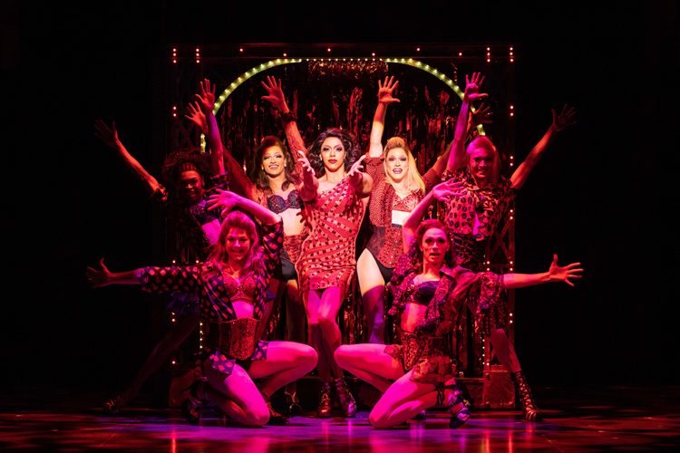 Callum Francis as Lola with the Angels in Kinky Tour. Photo Helen Maybanks