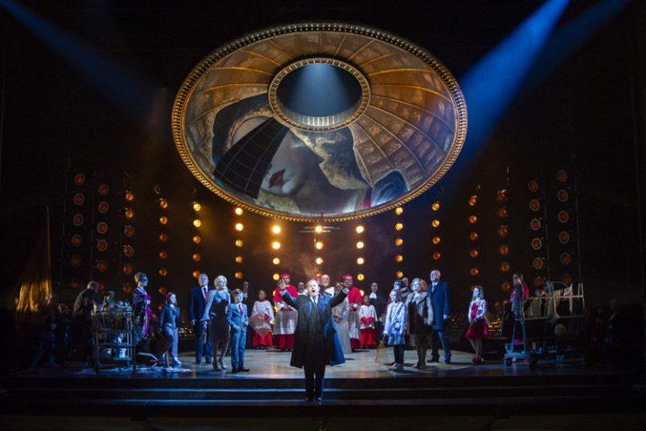 Robert Hayward as Scarpia and the Chorus of Opera North. Photo credit: Richard H Smith