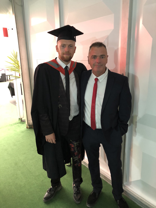 A more recent picture of my Dad and I, celebrating my graduation and looking to the promising future. Spot the roses.