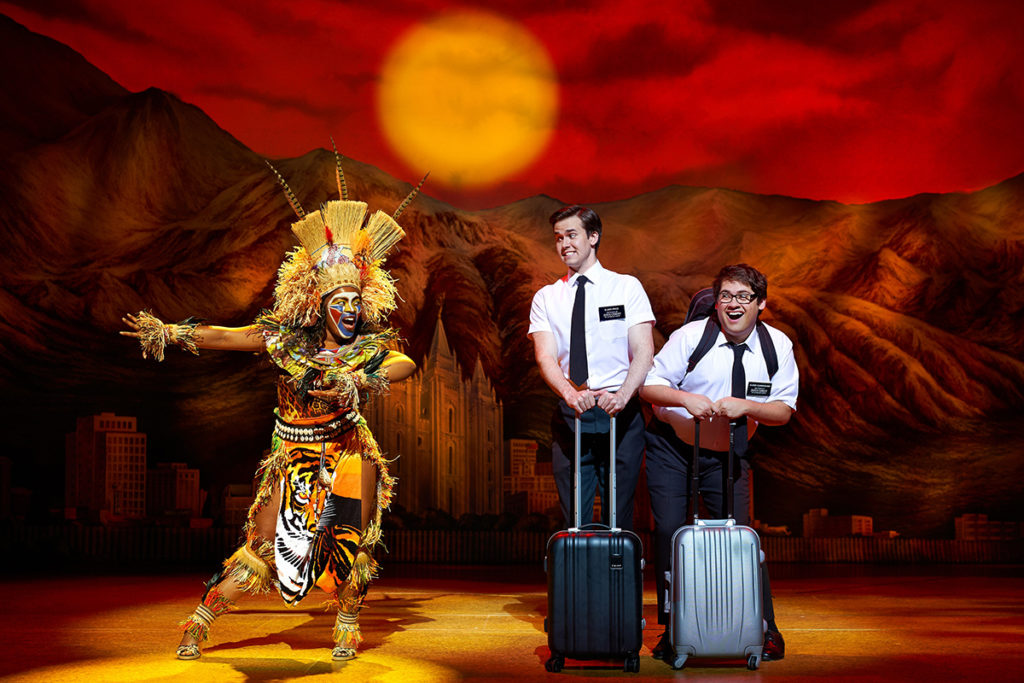 M Jae Cleopatra Isaac, Kevin Clay, Conner Peirson in The Book of Mormon. Credit: Paul Coltas