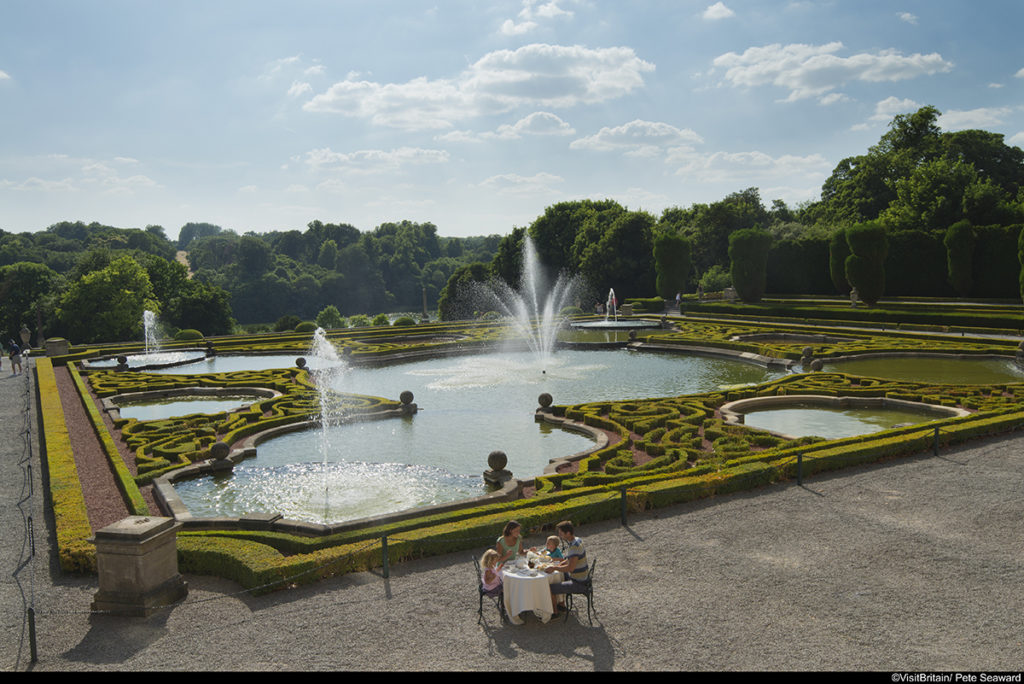 Blenheim Palace Terrace. A family taking afternoon tea in front of the fountains.