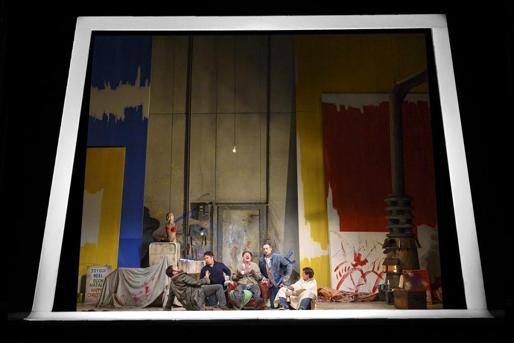 Opera North's production of Puccini's La Bohème Emyr Wyn Jones as Colline, Eleazar Rodriguez as Rodolfo,Jeremy Peaker as Benoît, Yuriy Yurchuk as Marcello and Henry Neill as Schaunard Photo credit: Richard H. Smith