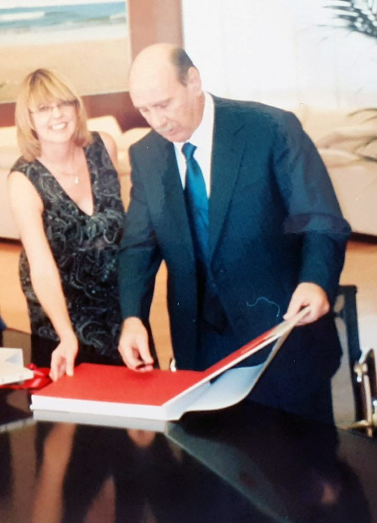 Lorraine receiving a commorative book from the Mayor of Benidorm