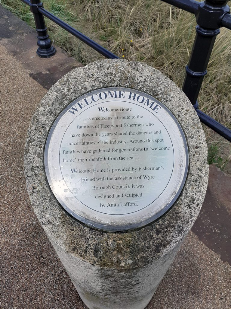 Stone depicting details of the Welcome Home statue Fleetwood