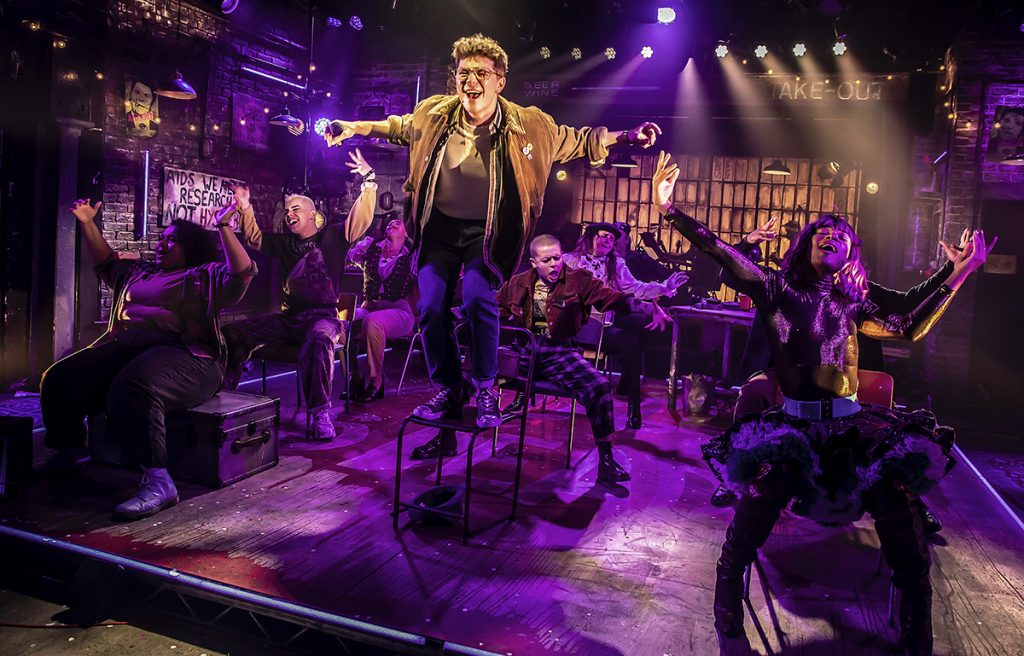 Blake Patrick Anderson (Mark) and the Company of RENT at Hope Mill Theatre. Photographer Pamela Raith