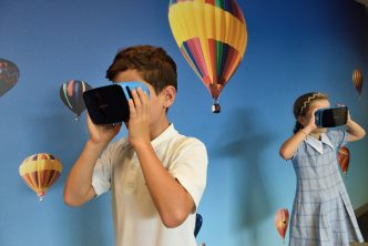 Boy and girl using VR headsets