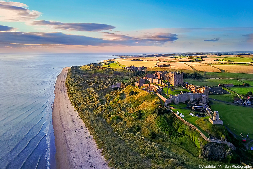 Aerial view of Bamburgh Castle on the coast of Northumberland, England