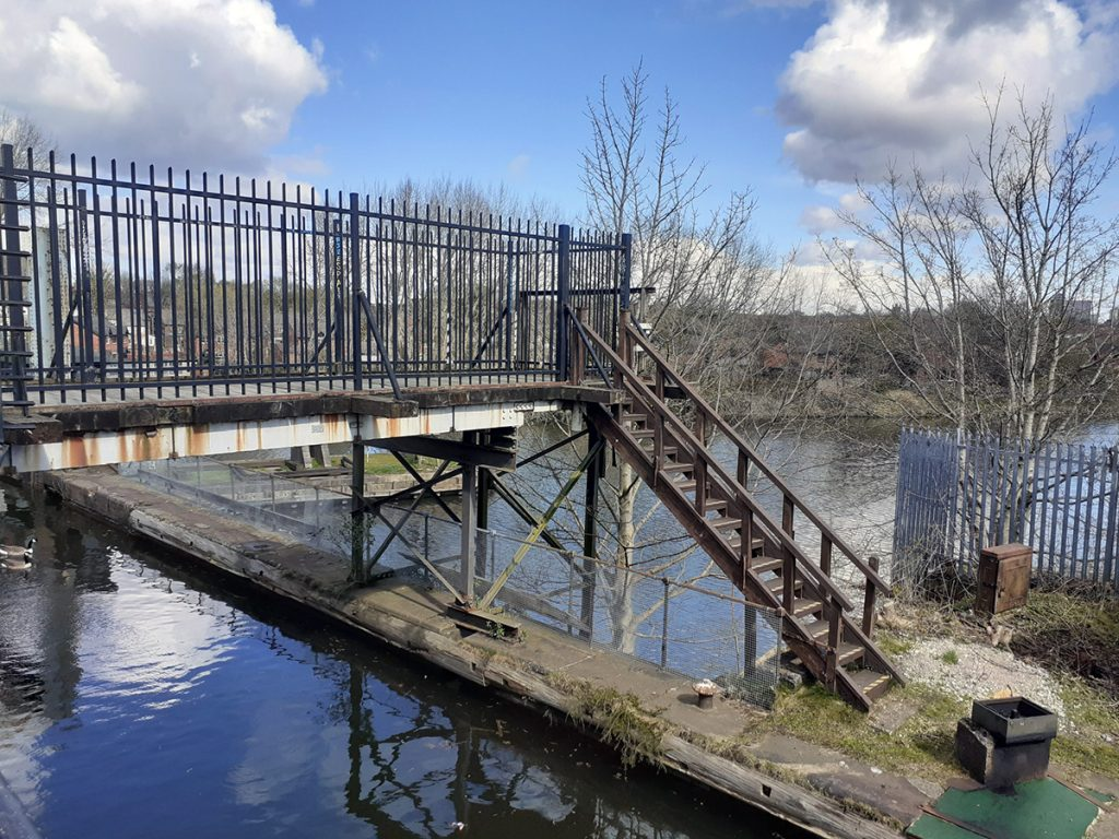 There are steps available to see the water in the swing bridge