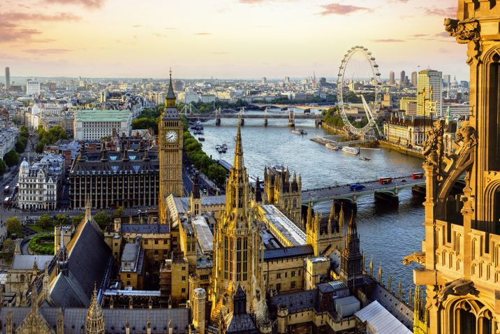 View from Victoria Tower of the Houses of Parliament, the River Thames, Westminster and Westminster Bridge, with the London Eye in the distance, London, England.