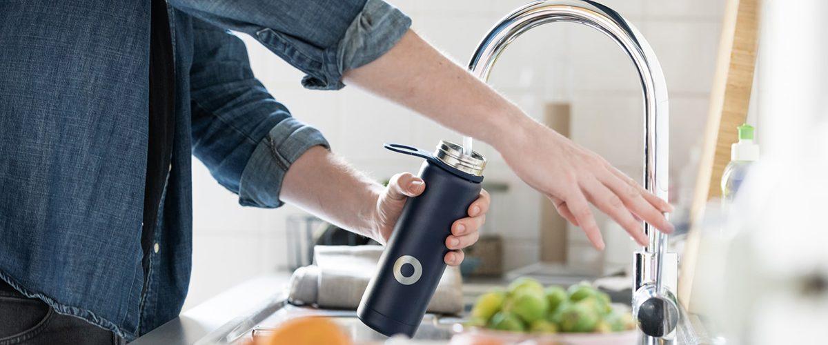 Filling water bottle from tap